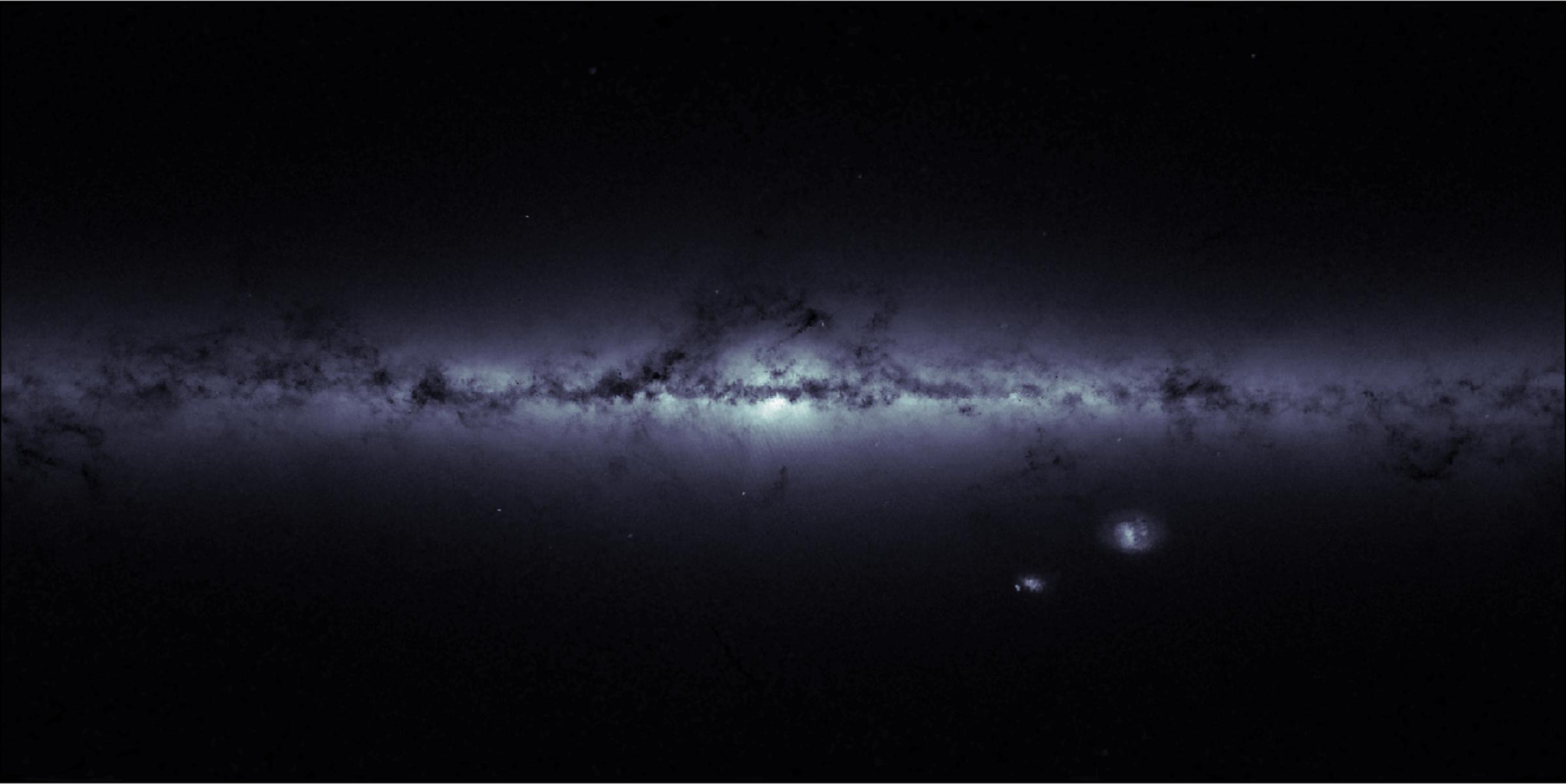 Слика 3. Нашата галаксија, Млечниот пат, погледната низ инструментите на Гаиа. Сликата е составена од помошните податоци користени за калибрација на првото издание. Посветлите региони имаат поголема густина на ѕвезди, додека во потемните места бројот на набљудуваните ѕвезди е помал.